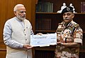The DG, ITBP, Shri R.K. Pachnanda presenting a cheque of Rs.8.5 crore to the Prime Minister, Shri Narendra Modi, towards the Prime Minister's National Relief Fund, in New Delhi on September 10, 2018.JPG