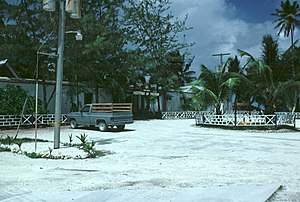 Diego Garcia - This 1982 photo shows an unpaved road made of crushed coral common throughout the island and the officers' dining area at the Diego Garcia Naval Support Facility.