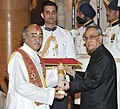 The President, Shri Pranab Mukherjee presenting the Padma Bhushan Award to Dr. Pandit Gokulotsavji Maharaj, at a Civil Investiture Ceremony, at Rashtrapati Bhavan, in New Delhi on April 08, 2015.jpg