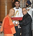 The President, Shri Pranab Mukherjee presenting the Padma Bhushan Award to Swami Satyamitranand Giri, at a Civil Investiture Ceremony, at Rashtrapati Bhavan, in New Delhi on April 08, 2015.jpg