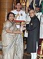 The President, Shri Pranab Mukherjee presenting the Padma Shri Award to Smt. Ushakirna Khan, at a Civil Investiture Ceremony, at Rashtrapati Bhavan, in New Delhi on March 30, 2015.jpg