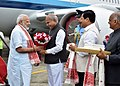 The Prime Minister, Shri Narendra Modi being welcomed by the Governor of Assam, Shri Banwarilal Purohit and the Chief Minister of Assam, Shri Sarbananda Sonowal on his arrival, in Dibrugarh, Assam on May 26, 2017.jpg