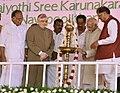 The Vice President, Shri M. Hamid Ansari lighting the lamp at the inauguration of the Navapoojitham (90th Birthday) celebrations of Navajyothi Sree Karunakara Guru at Santhigiri Ashram, in Thiruvananthapuram, Kerala.jpg
