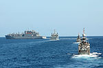 The dry cargo and ammunition ship USNS Washington Chambers (T-AKE 11), left, leads a formation of ships, including the Royal Thai Navy amphibious dock landing ship HTMS Angthong (LPD 791), center, and the Royal 130608-N-AX577-105.jpg