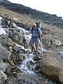 The seasonal melt washes over Gunsight Pass Trail from the northern slope of Mount Jackson. - panoramio.jpg