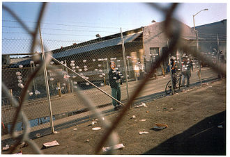 "San Francisco newspaper strike of 1994 - A protester spells out ""CONTRACT"" on fence with styrofoam cups during the strike"
