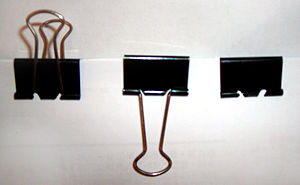 Binder clip - The handles can be folded down once the clip has been attached, and can also be removed for a semi-permanent binding.