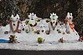 Traditionally ornamented snowmen found enroute to nathya gali.jpg