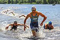 Triathletes after swimming in a river runs ashore (35609154246).jpg