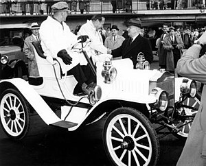 Maxwell automobile - Comedian Jack Benny (shown here shaking hands with Harry S. Truman from the seat of a c. 1908 Maxwell Roadster) kept the Maxwell familiar in U.S. popular culture for half a century after the brand went out of business.