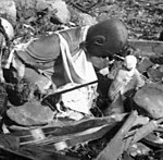 Two buddha statues detail, Nagasaki temple destroyed (cropped).jpg
