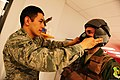 U.S. Air Force Airman 1st Class Adolfo Villegas, left, with the 5th Operations Support Squadron, fits a pilot with an oxygen mask at Minot Air Force Base, N.D., April 21, 2011 110421-F-MS729-137.jpg