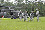 U.S. Army Reserve Soldiers with the 320th Military Police Company, learn how to carry a simulated casualty from a UH-60M Black Hawk helicopter during a joint Florida Army National Guard and Reserve medical 120720-A-HX398-145.jpg