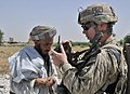 U.S. Army Staff Sgt. Jeremy N. Butler, right, with the 2nd Battalion, 23rd Infantry Regiment, conducts a biometric enrollment at a traffic control point in the Panjwai district, Kandahar province, Afghanistan 130523-A-MX357-179.jpg
