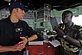 U.S. Coast Guard Lt. Randy Sinclair, left, assigned to a maritime security response team, discusses boarding strategies with Senegalese navy Ensign Alimamy Bassene, aboard the guided missile frigate USS Simpson 120617-N-GN377-006.jpg