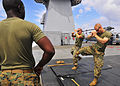 U.S. Marine Corps Sgt. Gabriel Perez, center, and Capt. Chris Tucker, both assigned to Fleet Anti-terrorism Security Team Pacific (FASTPAC), perform mixed martial arts techniques while Sgt. William Ford observes 130528-N-QD718-179.jpg