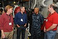 U.S. Navy Mass Communication Specialist 3rd Class Terry Godette escorts civilian visitors on a tour of the jet shop aboard the aircraft carrier USS Ronald Reagan (CVN 76) Nov. 7, 2013, in the Pacific Ocean 131107-N-AV746-531.jpg