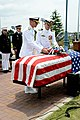 U.S. Navy Rear Adm. Matthew J. Carter, front left, the commander of Fleet Air Forward, and Capt. Steven Wieman, the commanding officer of Naval Air Facility (NAF) Atsugi, place a wreath on a flag-draped coffin 130527-N-OX321-132.jpg