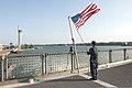 U.S. Navy Seaman Krystopher Weir prepares to lower the U.S. flag on high speed vessel Swift (HSV-2) before the ship leaves port in Mombasa, Kenya, July 7, 2012, during Africa Partnership Station (APS) 2012 120707-F-GA223-022.jpg