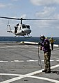 U.S. Sailors aboard amphibious transport dock ship USS New York (LPD 21) conduct flight operations as a UH-1N Huey helicopter takes off of the flight deck during African Lion 2012 in the Atlantic Ocean April 14 120414-N-XK513-054.jpg