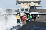 U.S. Sailors and Marines guide an F-A-18C Hornet aircraft assigned to Marine Fighter Attack Squadron (VMFA) 312 onto a catapult on the flight deck of the aircraft carrier USS Harry S. Truman (CVN 75) March 8 140308-N-ZG705-060.jpg