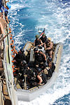 U.S. Sailors and Marines with the visit, board, search and seizure team, currently assigned to the guided missile cruiser USS San Jacinto (CG 56), climb onboard from a rigid hull inflatable boat, after 100524-N-EF447-251.jpg