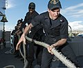 U.S. Sailors heave a line aboard the guided missile cruiser USS Philippine Sea (CG 58) as it pulls out of Piraeus, Greece, March 7, 2014 140307-N-PJ969-028.jpg