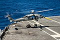 U.S. Sailors stationed aboard the aircraft carrier USS George Washington (CVN 73) prepare to connect cargo legs and nets to an MH-60S Seahawk helicopter assigned to Helicopter Sea Combat Squadron (HSC) 25 during 131115-N-IP531-301.jpg