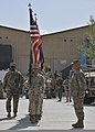 U.S. Service members with NATO Training Mission-Afghanistan (NTM-A) and Combined Security Transition Command-Afghanistan (CSTC-A) carry flags during a change of command ceremony at Camp Eggers, Afghanistan 130402-N-HU588-010.jpg