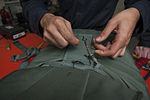 USS Carl Vinson Sailors conduct parachute maintenance 141111-N-TP834-062.jpg