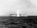 USS Langley (AV-3) is hit by torpedo on 27 February 1942.jpg