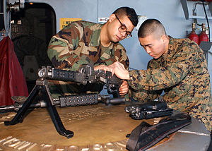 US Navy 030104-N-4430H-046 disassembly of an M-60 assault rifle.jpg