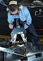 US Navy 030308-N-0068T-008 Damage Controlman Fireman Casey Thompson demonstrates how to make an access hole using the Portable Hydraulic Access Rescue System.jpg
