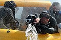 US Navy 040127-N-5362A-002 An aviation survival student bails water out of life raft during a storm scenario held as part of a refresher-training course.jpg