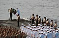 US Navy 040718-N-0535P-039 Sailors and Marines salute while a wreath is committed into the Atlantic Ocean during a wreath laying ceremony held on the flight deck of USS Harry S. Truman (CVN 75) in memory of Capt. Franklin Hooks.jpg