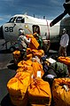 US Navy 040827-N-6213R-002 Sailors work to load bags of mail onto a C-2 Greyhound.jpg