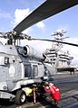 US Navy 041113-N-0057P-087 An Aviation Ordnanceman assigned to the Golden Falcons of Helicopter Anti-Submarine Squadron Two (HS-2), adjusts a weapons rack for AGM-114 Hellfire missiles on an HH-60H Seahawk.jpg