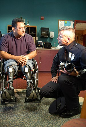 Veteran's pension (United States) - US Navy 051206-N-6843I-097 An injured Sailor speaks with a Los Angeles Police Department (LAPD) officer during a visit to Naval Medical Center San Diego (NMCSD)