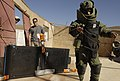 US Navy 051217-F-7234P-046 U.S. Navy Petty Officer 1st Class Frank Fazalore and Chief Petty Officer Zach Holzhausen, watch a Yemen Explosive Ordinance Disposal (EOD) team members prepare to x-ray a suspicious package.jpg