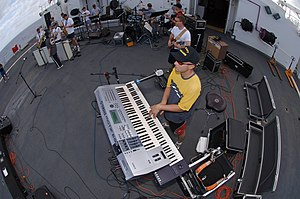 Keyboard amplifier - A US Navy keyboardist playing his Yamaha keyboard through a large  Roland keyboard amp.