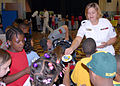 US Navy 070606-N-5268S-002 Cryptologic Technician Administration 1st Class Jennifer Archuleta hands out Submarine Force stickers to children from Ocean Air Elementary on career day.jpg