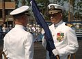 US Navy 070620-N-3674H-020 Commander 22nd Naval Construction Regiment, Capt. Eric S. Odderstol, left, transfers the regimental flag to Capt. Robert A. McLean at a change of command ceremony held at Naval Construction Battalion.jpg