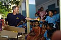 US Navy 070704-N-4420S-123 Lt. Cmdr. David Bynum, a Navy chaplain aboard USS Nimitz (CVN 68), passes out happy face sponge balls to the students of CSI High School for the Deaf during a community relations visit.jpg