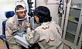 US Navy 070730-M-0000T-001 Cmdr. Karen Kato examines Petty Officer 2nd Class Michael Tuck Jr., at the Optometrist's Clinic on board the Troop Medical Clinic at Camp Arifjan, Kuwait.jpg