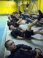 US Navy 071010-N-5319A-007 Aviation Warfare Systems Operator 2nd Class Roger Richards directs Rescue Swimmer School candidates in morning physical training at Naval Air Station Pensacola.jpg