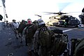 US Navy 071104-N-7027P-051 Prior to flying ashore during a crisis response exercise, Chief Warrant Officer Bryan Simon ensures Marines attached to 4th Platoon 2nd Fleet Anti-terrorism Security Team (FAST) cross the flight deck.jpg