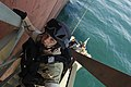 US Navy 080206-N-2420K-128 Sonar Technician Surface 2nd Class Joshua Vanhooser, a member of the guided-missile frigate USS Ingraham (FFG 61) visit, board, search and seizure team, climbs the accommodation ladder.jpg