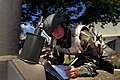 US Navy 080716-N-0260R-067 Storekeeper 2nd Class Marcus Harvey, assigned to explosive ordinance disposal Operation Support Unit 7, records notes on a simulated explosive device.jpg
