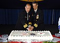 US Navy 090410-N-6523K-060 SS George Washington (CVN 73) commanding officer Capt. David A. Lausman (right) and Capt. J. R. Haley cut a cake after their change of command ceremony.jpg