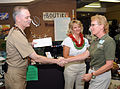 US Navy 090413-N-3666S-018 Capt. Richard Kitchens and Julie Smithpresent KT Budde-Jones with a check during a donation ceremony at the Boutiki Gift Shop at Naval Station Pearl Harbor.jpg